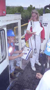 IT Dredge Operator, Martha Johnson (pictured left) is shown holding the MC-2000 Operations & Parts Manual. Kathy Kluge (pictured right), Mud Cat Literature Department Manager, produced the manual at Mud Cat's headquarters in Baltimore.